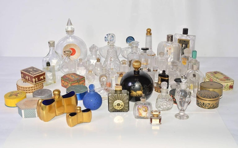 A wonderful and selective collection of vintage perfume bottles, including Guerlain and Dion with some bottles manufactured by Baccarat and Lalique.
