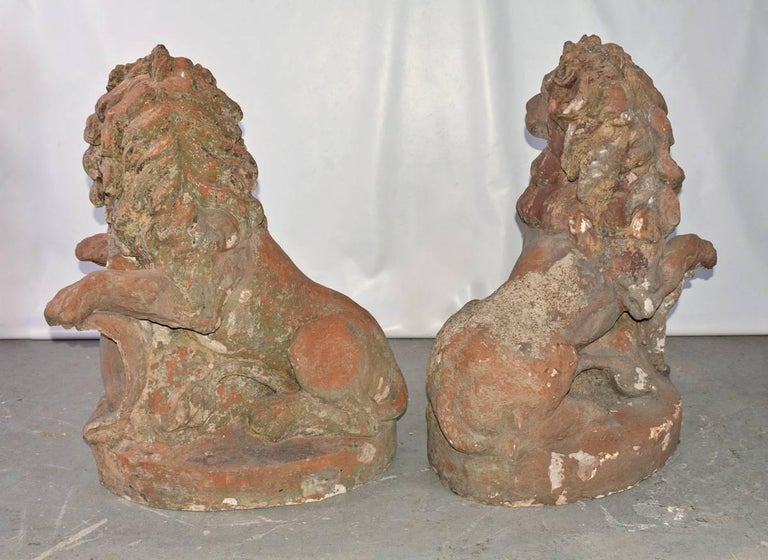 Cast Pair of 19th Century Terracotta Lions For Sale