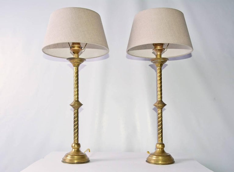 Pair of antique French Gothic Revival style brass table lamps with Belgium, linen shades. Great original condition with patina.