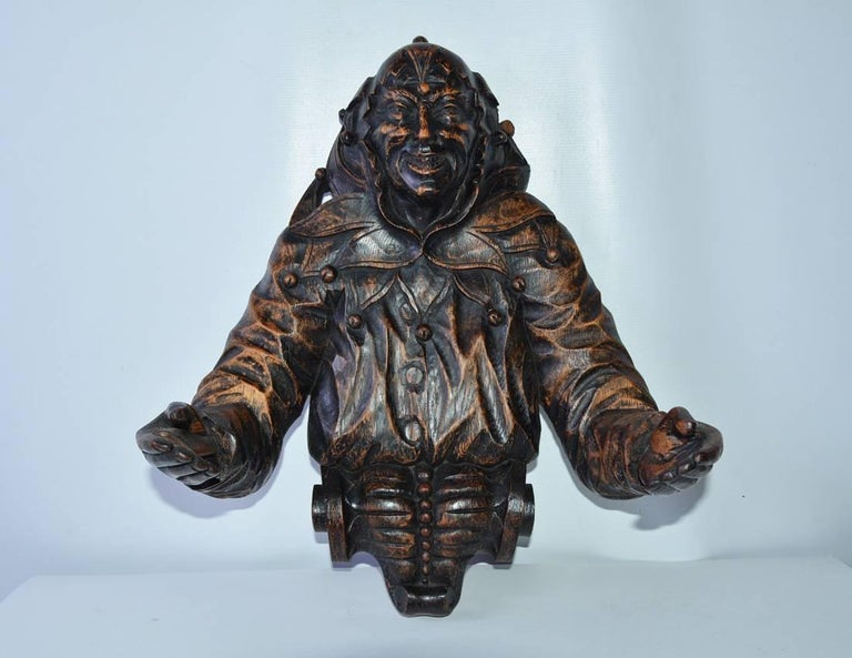 Rare Gothic style carved wood jester. Can be standing or wall hung.