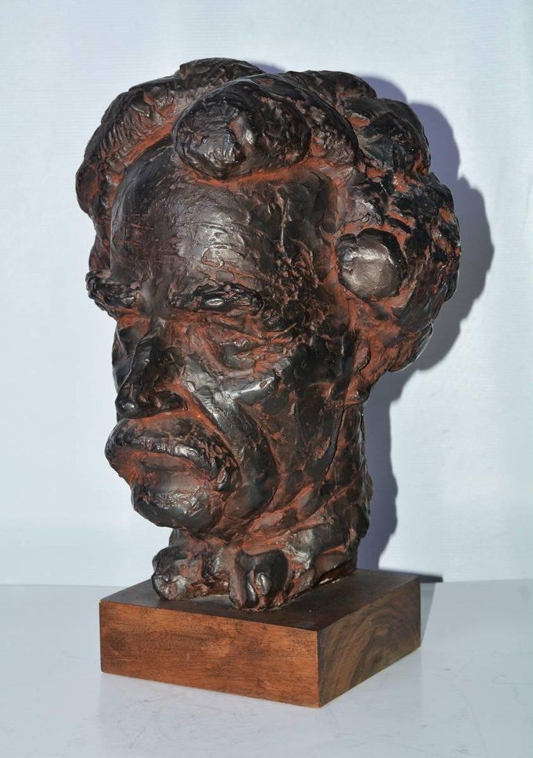 Bust/Head, a bronzed plaster sculpture cast of Mark Twain with lifelike details.