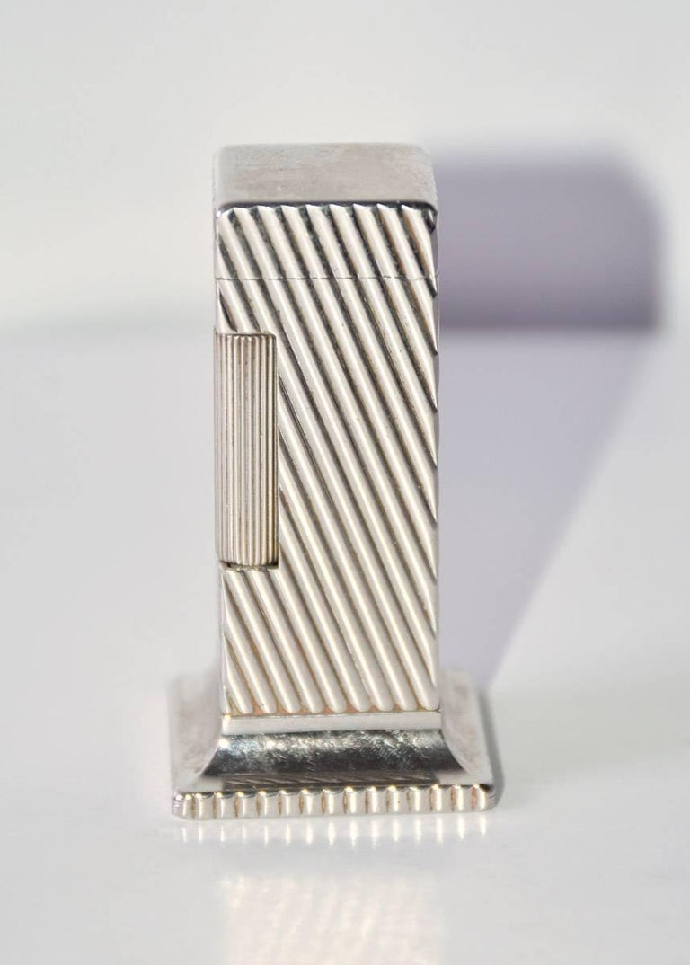 Elegant and stylish, the Dunhill Rollalite 'Diagonal Line' is one of the most famous lighters made by Dunhill. It was first manufactured between 1949 in the United State and Switzerland by Alfred Dunhill ltd. The production of the wick lighter