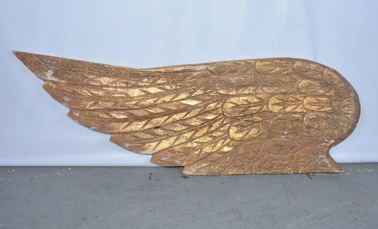 Hand-Carved Pair of Ornamental Carved Wood Gilded Angel Wings For Sale