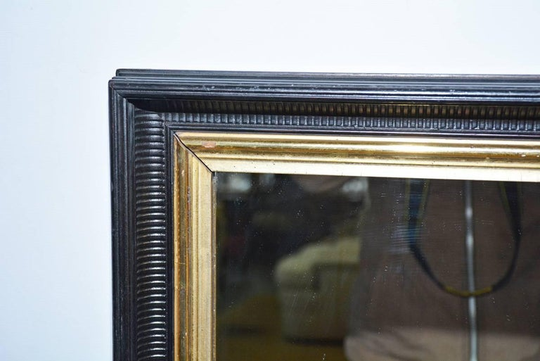Neoclassical Vintage Black and Giltwood Mirror For Sale