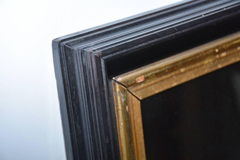 American Vintage Black and Giltwood Mirror For Sale