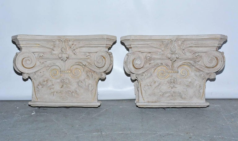 Pair of 19th century plaster detail from a classical building in France. Were the capitals on top of two columns. Can be wall mounted sculptures or brackets.