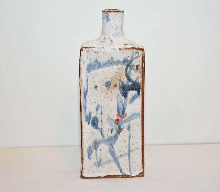 Classic low-fire stoneware bottle with white glaze and blue decoration. Can be used as vase, sake vessel or simply decoration.