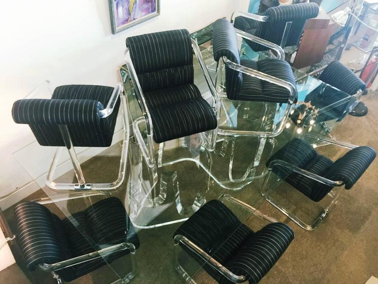 Set of eight armchairs in thick molded tubular Lucite with chrome fittings. Each base is signed by Lion in Frost.  The fabric (silk) is original. Wear consistent with age and use. For two of them, the fabric has been ripped off on some part. Anyway,