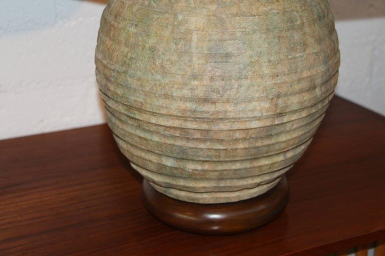 A nice vintage pair of ribbed stoneware pottery lamps with nice shades. Appear to be vintage 1960s perhaps. In working order. Shades included. Dimensions given are for the total height and the diameter is for the poetry itself. The pottery is 12