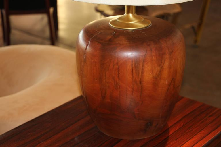 A extremely heavy turned wood base turned into a lamp. Nice patina to the wood and great cracking and character to the lamp. Wood part alone is 11 inches tall and 10 inches in diameter. The cord shows it's age maybe 1960s-1970s.