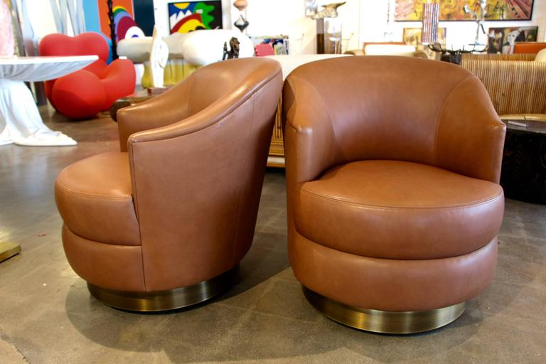 A Rudin Leather Swivel Chairs With Brass Base Ordered By