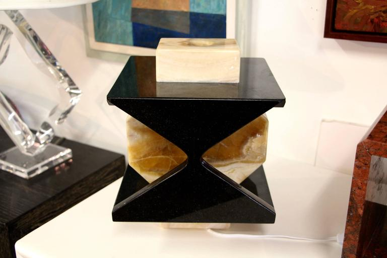 We recently started buying from a local artist Carlos Gaona, who is wonderfully talented. This lamp is a one-of-a-kind piece and is quite lovely. It is a nicely colored onyx and granite. New wiring of course.