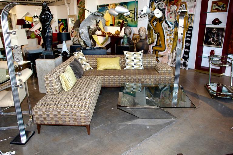 A nice sectional two-piece sofa in a nice decorative pattern. Wood legs and a nice grouping of accent pillows. Please note that this set only comes with three pillows, the green/yellow ones are not included. Width measurements are from widest part