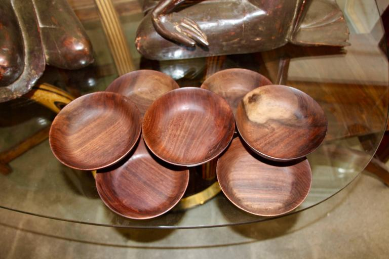 A nice set of seven black walnut hand-turned bowls by the noted Californian woodworker Bob Stocksdale. They are in good age appropriate condition with minor nicks, marks and losses.