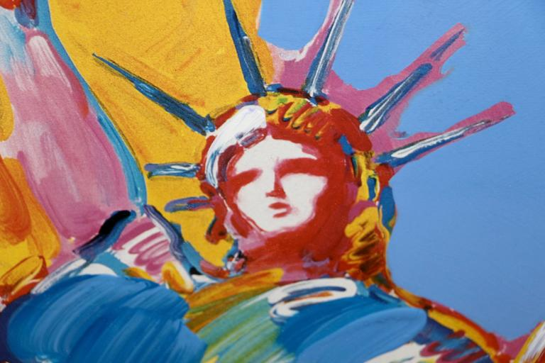 A unique work of art by Peter Max out of his Statue of Liberty series from 2001. This is a Mixed Media with Acrylic painting and color lithography on paper. It is signed upper right in acrylic. Beautifully framed. The black mesh back has some dust