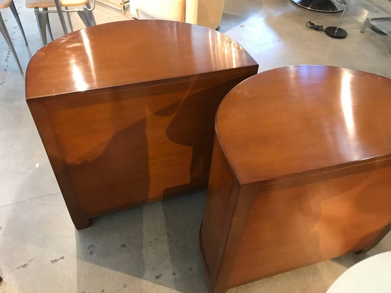 A nice pair of labelled Nancy Corzine demilune highly polished high quality end tables or nightstands. They feature interesting pulls. The drawers have the name marked on the inside. These tables are highly polished and were difficult to photograph.