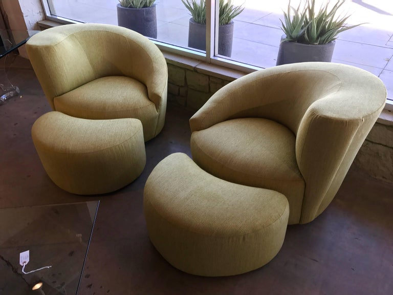 A newly upholstered pair of Vladimir Kagan nautilus chairs and matching ottomans. They have been redone in a beautiful Citrus Chenille fabric. The round swivel bases have been upholstered as well. Please note these are right and left pair. The