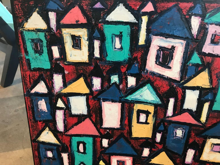 Rahmon Olugunna is a noted Nigerian artist. This painting is titled dark village and is vibrant and colorful.
