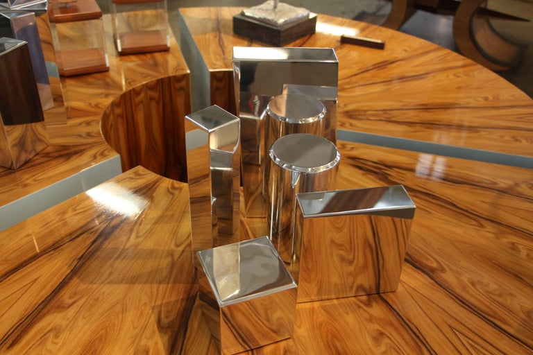 Our gallery is proud to represent an new talented artist Casey Cross who now resides in Palm Springs, CA. His work is unique and quite unusual. These geometric shapes can be arranged in any way. They are polished aluminium shapes. Each piece has