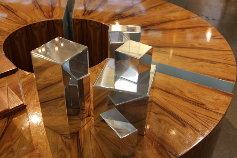 Our gallery is proud to represent an new talented artist Casey Cross who now resides in Palm Springs, CA. His work is unique and quite unusual. These geometric shapes can be arranged in any way. They are polished aluminum shapes. Each piece has been