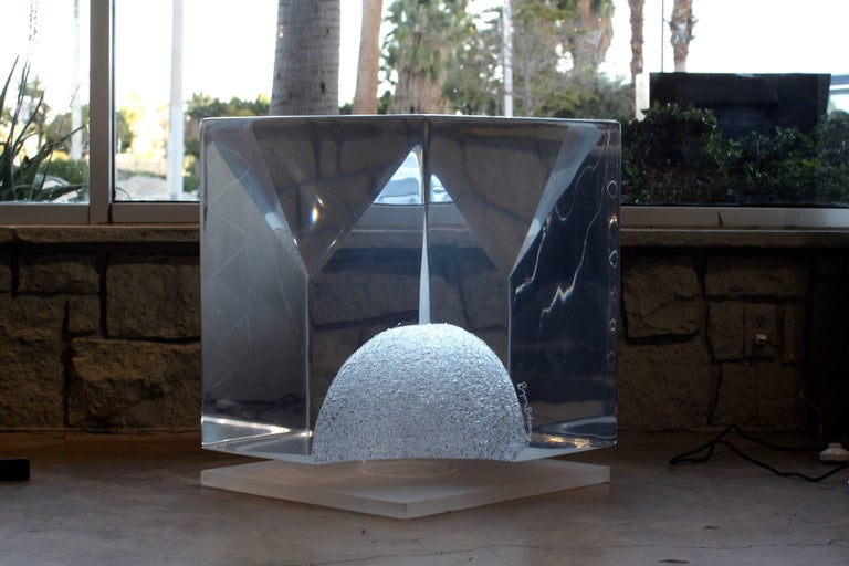 A massive 450 pound Lucite sculpture by the noted artist Bijan Bahar. This piece is enormous and quite impressive. It looks great with the led light changing colors which will accompany the piece. It features an etched signature. This piece was