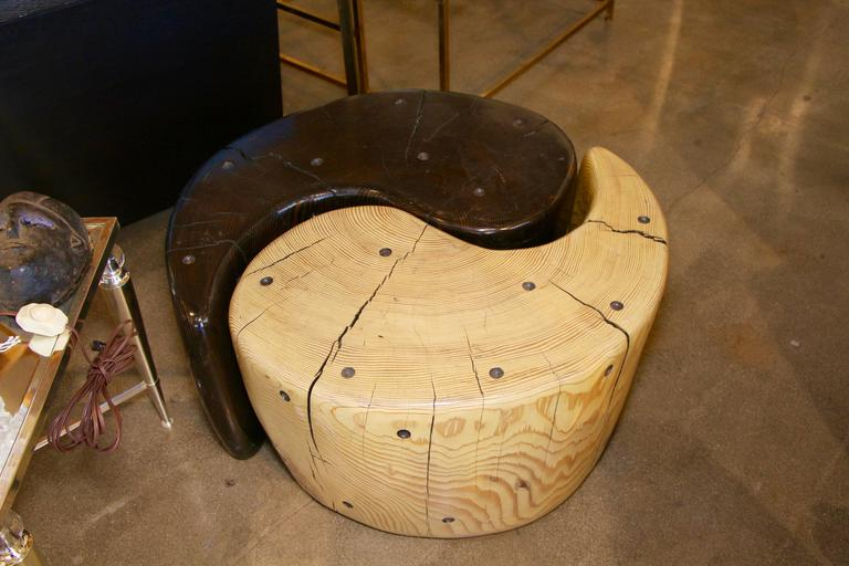 A most impressive Yin Yang table by the noted California wood worker Daniel Pollock. I believe each piece is unique and from fallen wood that the artist finds. The graining on this piece is wonderful. The cracking to the wood is natural. It is