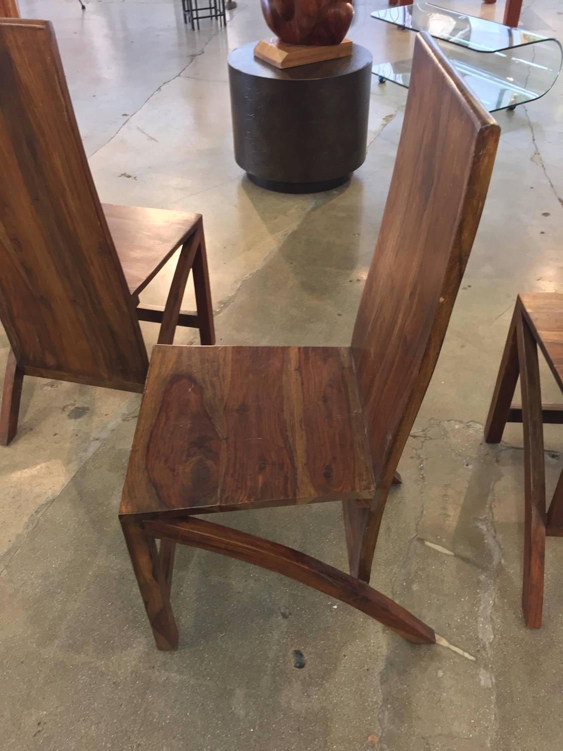 Set of four sculptural exotic wood handmade chairs for