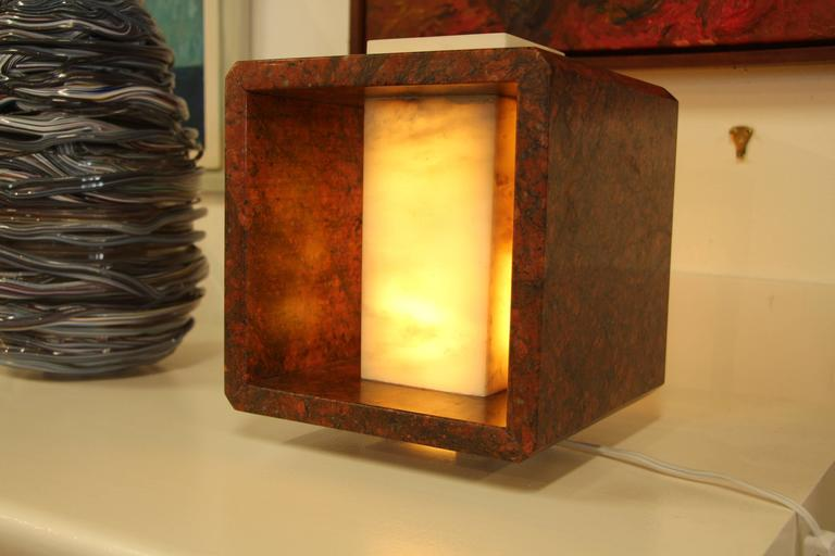We recently started buying from a local artist Carlos Gaona, who is wonderfully talented. This lamp is a one-of-a-kind piece and is quite lovely. It is a nice red marble. New wiring of course.
