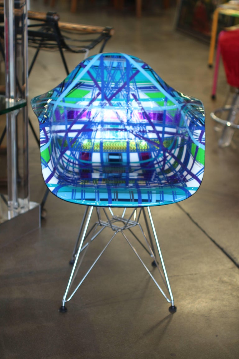 A wonderfully decorated chair by the noted Brazilian American artist Mauro Oliveira. This chair is titled