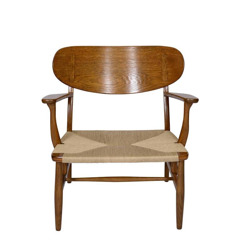 Scandinavian Modern Hans Wegner CH-22 Lounge Chair For Sale