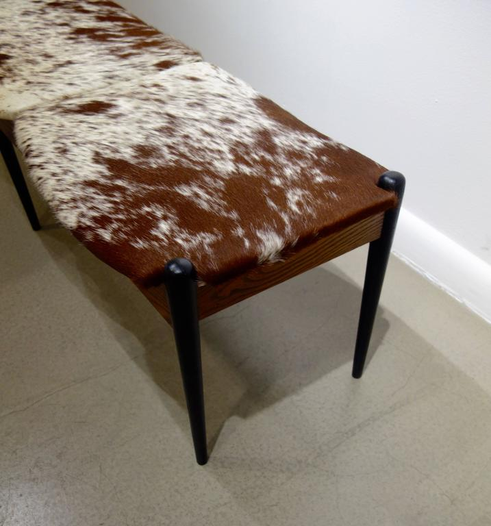 Mid-Century Modern Danish Three-Seat Ebonized & Oak Brown and White Cowhide Upholstered 1960s Bench For Sale