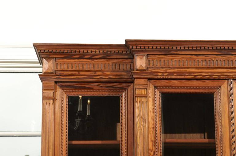 French Pitch Pine Glass Doors Breakfront Bookcase from the Turn of the Century In Good Condition For Sale In Atlanta, GA
