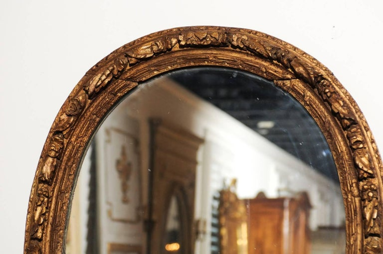 Wood French Louis XIV Period 1710s Giltwood Oval Mirror with Carved Rosettes For Sale