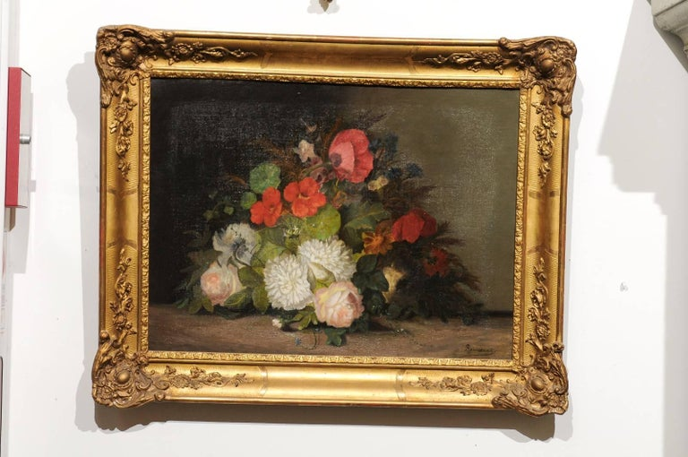 A 19th century framed oil on canvas floral painting signed by French artist Philippe Rousseau (1816-1887). This French still-life painting depicts an exquisite bouquet of flowers placed on a neutral background, in a manner resembling the production
