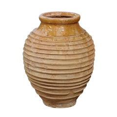 Greek Early 19th Century Round Terracotta Olive Jar with Ribbed Body and Glaze