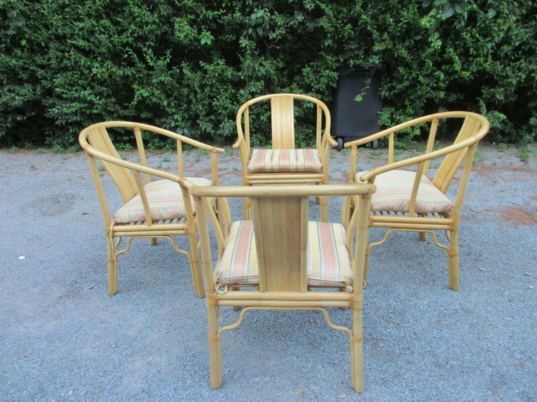 Set of four-light bamboo armchairs with custom cushions....price is for the set