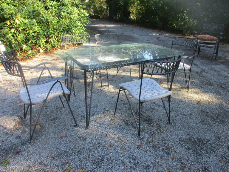 Salterini garden or patio set Glass top table with four armchairs and three side chairs.