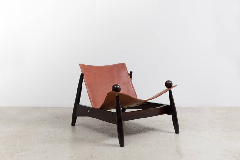 Pair of vintage Brazilian armchairs designed in the 1960s, made of Jacaranda wood and belt leather.