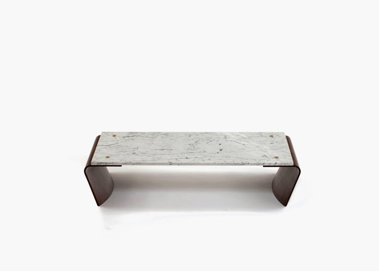 """The """"Romana"""" coffee table was originally designed in the 1960s by Jorge Zalszupin. With a marble top affixed on thin, exquisitely curved wooden bases, the Romana coffee table seems to defy the weight of its materiality with its elegantly imposing"""