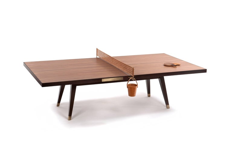 The luxurious Ping Pong table designed by Dado Castello Branco takes the popular game to the next level.  Features: Two paddles with their respective leather covers Leather Net Leather bucket for storing game balls Carefully handcrafted in