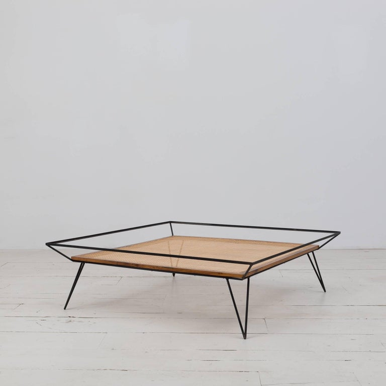 Exquisite Vintage coffee table designed by Martin Eisler and Carlo Hauner in the 1950s. Iron base structure, solid Caviuna wood, and natural cane.   Size: W 47