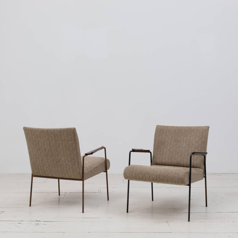 "Pair of vintage ""Leve"" Armchairs designed by Joaquim Tenreiro in the 1950s. Metal base structure, solid Jacaranda wood arms, and fabric upholstery.