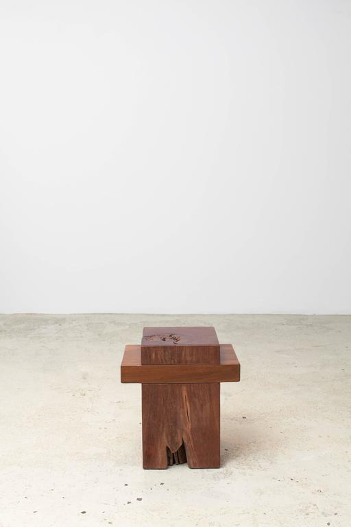 "The ""Joá"" stool repurposes contrasting Maçaranduba and Ipê antique wood columns for its sculptural and minimal design. Registers of the materials' original use further enhances its warmth and history, revealing the thoughtful approach of"