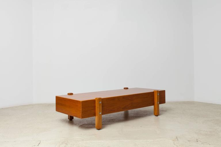 A rare vintage coffee table by master Sergio Rodrigues. Caviúna wood veneer, solid wood legs, chromed buttons. Can also be used as a coffee table.