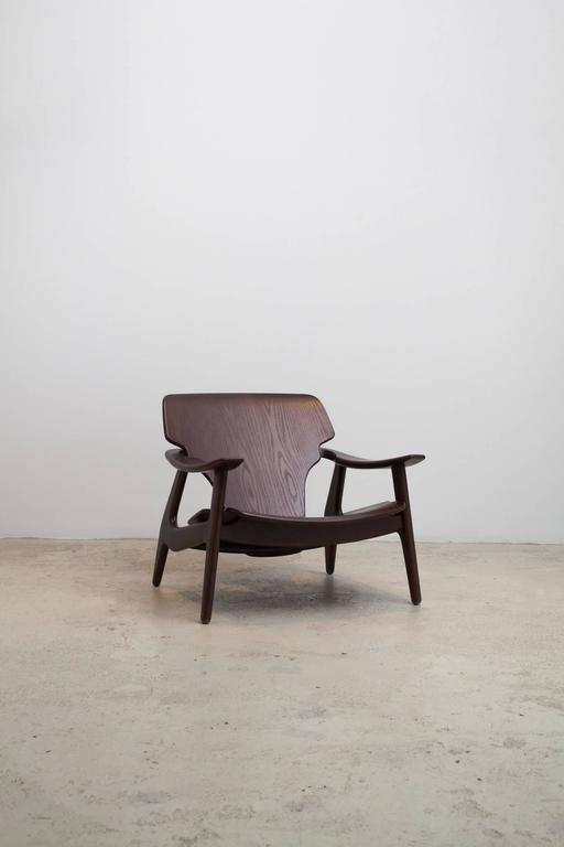 """Marked by sculptural lines, the elegant """"Diz"""" armchair is visually lightweight and outstandingly ergonomic. The organic, undulating lines are a natural progression of Rodrigues´ aesthetic.  Designed by Brazilian furniture master Sergio"""