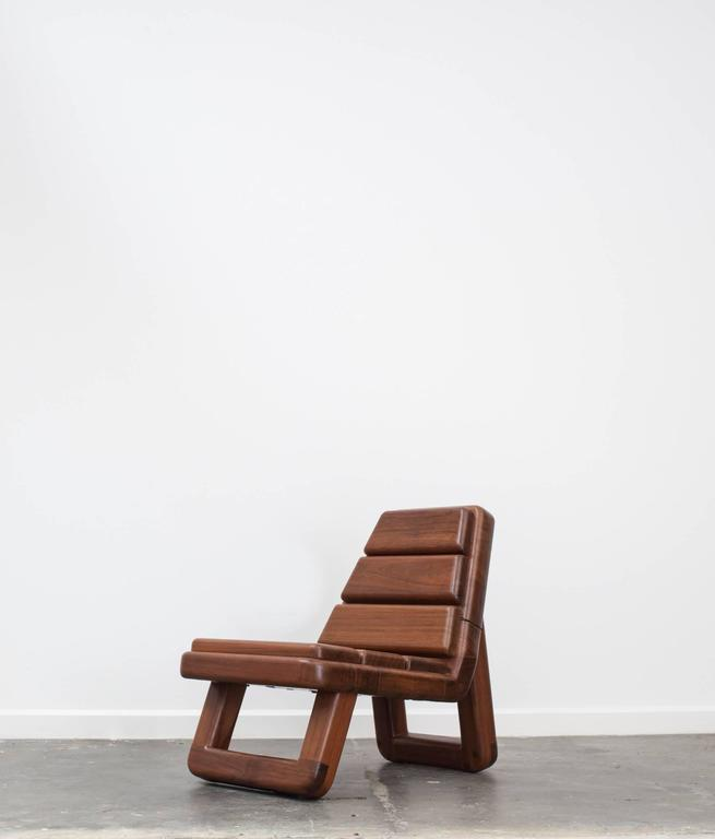 Beautifully sculpted from reclaimed Ipe wood, the Anil armchair playfully re imagines notions of hard and soft as its handcrafted seat and back echoes a plush upholstered piece.  Edition 1 of 3.  Three available in total.