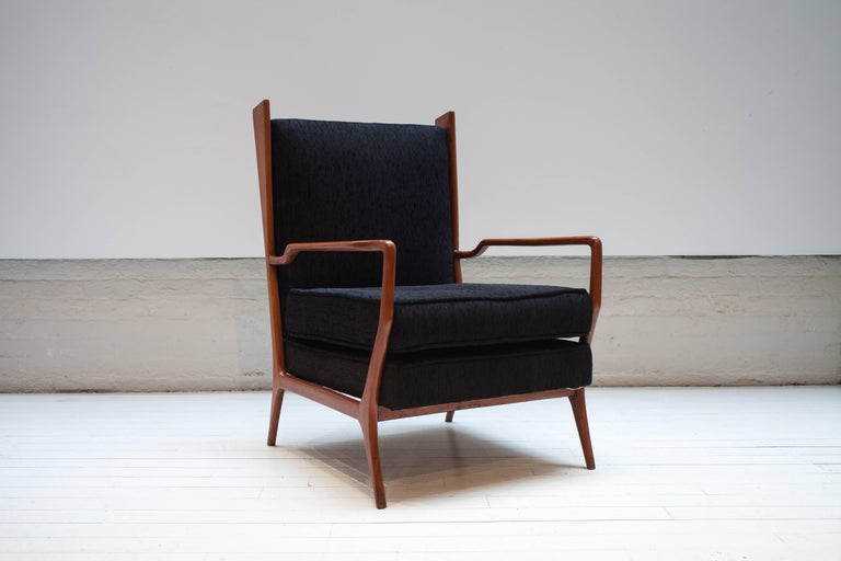 Rare vintage 1960s Rino Levi armchairs in fabric and caviuna wood. Fabric and caviuna wood Size: W 25