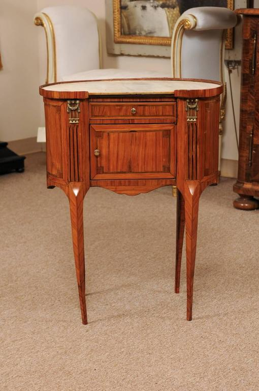 18th century French Louis XVI period kidney shaped tulipwood table with drawer, cabinet door, & marble top.