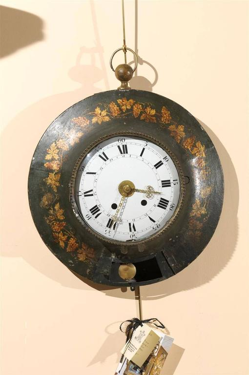Large 19th century French painted tole wall clock with grapevine detail.
