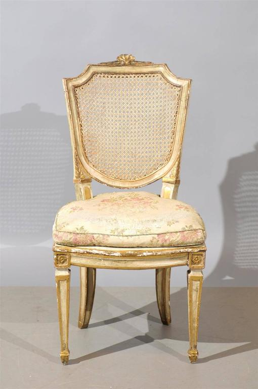 Set of six 19th century Italian neoclassical style painted and cane dining chairs. Also, can be sold in pairs. 